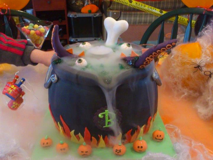 Cauldron design cake with dry ice fog flowing out of it